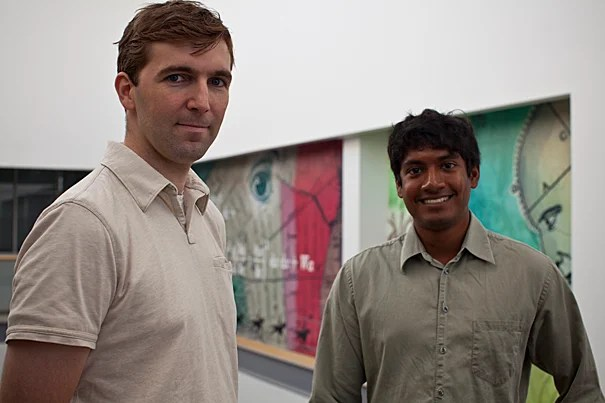 Associate Professor of Electrical Engineering Robert J. Wood (left) and graduate student Pratheev S. Sreetharan are working on miniature flying vehicles that could someday be used to probe environmental hazards, forest fires, and other challenges too perilous for people.