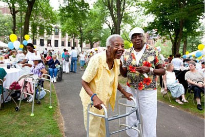 Erna Benjamin and Joyce Lee Smith enjoy the the 35th Annual Harvard Yard Picnic for Cambridge senior citizens, which is sponsored by the Office of the Mayor for Cambridge and the Office of the President of Harvard University.