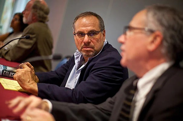 """Bruce Gellerman (left), host of the public radio program """"Living on Earth,"""" joined Graduate School of Arts and Sciences Dean Allan Brandt on a panel to discuss science's seeming inability to stand toe-to-toe with corporate interests over issues of fact when dollars are at stake."""