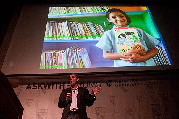 John Wood, founder of Room to Read, which educates children in the developing world through initiatives on literacy and gender equality in education, speaks at the Harvard Graduate School of Education on Nov. 4. In 10 years, Room to Read has opened 1,000 schools, provided 10,000 long-term scholarships to girls, and opened more than 10,000 bilingual and multilingual libraries, serving more than 4 million children.
