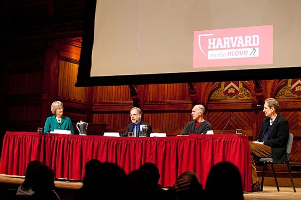 """Harvard on the Move, a new initiative sponsored by President Drew Faust (from left), kicked off with a panel discussion at Sanders Theatre on Wednesday. Panelists included Daniel Lieberman, professor of human evolutionary biology and department chair of human evolutionary biology in the Faculty of Arts and Sciences, Christopher McDougall '85, author of """"Born to Run: A Hidden Tribe, Superathletes, and the Greatest Race the World Has Never Seen,"""" and John Ratey, an associate clinical professor of psychiatry at Harvard Medical School."""