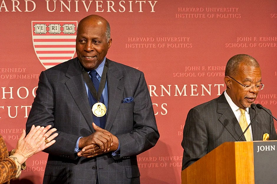 Dec. 4, 2009. Vernon E. Jordan Jr. accepts his Du Bois Medal at a ceremony at the Harvard Kennedy School. Henry Louis Gates Jr. (right), Alphonse Fletcher University Professor and director of the W.E.B. Du Bois Institute for African and African American Research at Harvard University, helped present the awards, which are given to individuals whose work has contributed significantly to African and African-American culture. Photo by Jill Foley