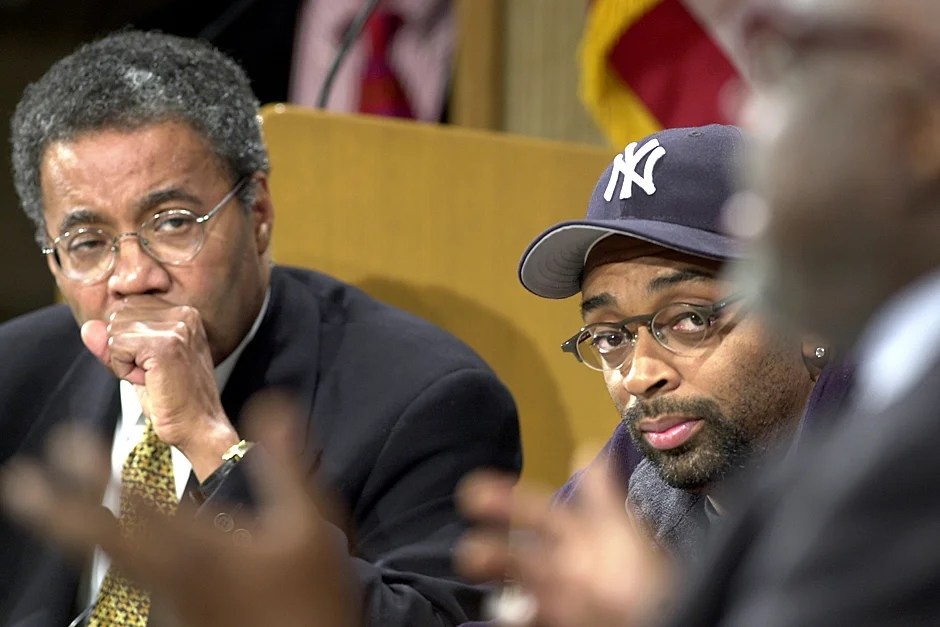 """Nov. 6, 2000. Harvard Medical School Faculty Associate Dean for Student Affairs Alvin Poussaint (left) and movie director Spike Lee listen to cultural and jazz critic Stanley Crouch speak during a discussion at the Harvard Kennedy School about Lee's movie """"Bamboozled"""" and race in the media. Photo by Justin Ide/Harvard Staff Photographer"""