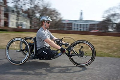 """Andrew Kinard lost his legs in Iraq but made a promise to himself that the wounds he suffered in battle wouldn't control his life: He is currently pursuing a joint Harvard Law School/Harvard Business School degree and will be handcycling in the Boston Marathon. """"It's a decision I have to make every day, he said. """"It never goes away, but it's a commitment that I made."""""""