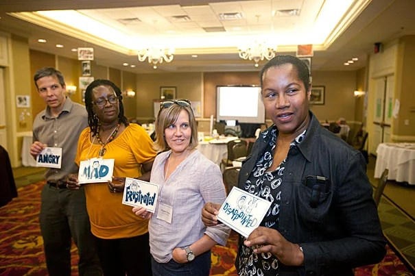 Sam Healy (from left), Centhelia James, Megan Nason, and Connie Redden participated in a hands-on exercise designed to provide educators with new tools and perspectives on how children think, perceive, and learn.