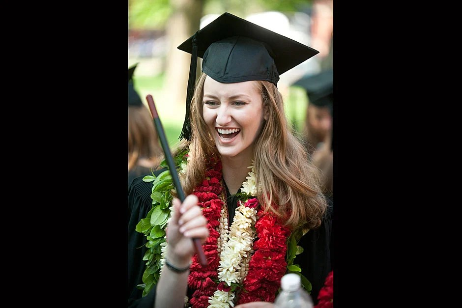 Dunsterite Zoe Morrison '11, who hails from Hawaii, sports a lei at Commencement's Morning Exercises. Jon Chase/Harvard Staff Photographer