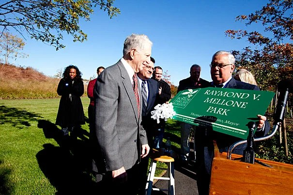 """The Honan-Allston Branch Library was renamed Raymond V. Mellone Park at an event hosted by Boston Mayor Thomas M. Menino (right). """"I don't think I'm the only one who ever did anything for the community; unfortunately there are not more parks to dedicate to individuals,"""" Mellon said (left). The park, which opened in July, was built by Harvard on 1.74 acres of vacant land."""