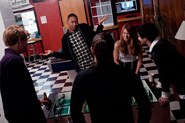 Eliot House resident Wesley Mann '13 celebrates a foosball goal inside the Eliot House Grille with Jordan Sessler '13 (from left), Devan Kennifer '12, Elena Pepe '13, and Steve Tricanowicz '13.
