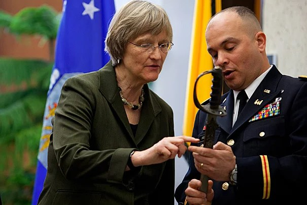 """To symbolize both our new beginning and our tradition"" at Harvard, Army Lt. Col. Timothy J. Hall, commanding officer of the Paul Revere Battalion at MIT, showed Harvard President Drew Faust a saber that had been issued on May 30, 1916 to Capt. Constant Cordier, commander of the 1,000-student Harvard Regiment, precursor of the Army ROTC. The saber will be on display in the new Army ROTC office in Hilles, said Hall, where it resumes ""its rightful place at Harvard."""