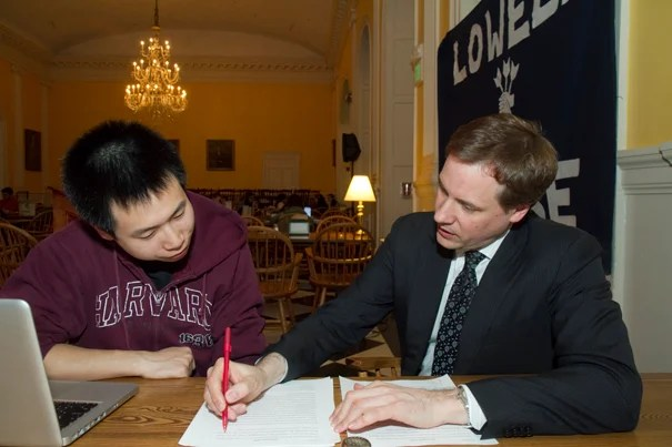 Gorick Ng '14 gets coached for his upcoming speech by David L. Ager, faculty adviser. The process is two-sided, with Ager saying he learns as much as his speakers do, or more, from these sessions.