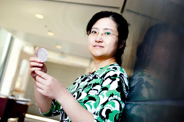"""Assistant Professor Yun Zhang, shown in the Northwest Science Lab last year, is working with colleagues to illuminate """"compartmentalized"""" neural activity in worms."""