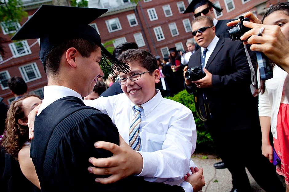 Eliot House graduate Oscar Zarate '12 is congratulated by his family after he receives his degree on Commencement Day. Stephanie Mitchell/Harvard Staff Photographer