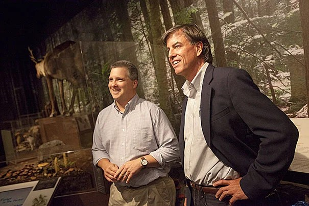Harvard Forest Director David Foster (right) and researcher David Orwig gave a recent talk on the pests and pathogens that threaten New England forests. Front and center are insects that have been in the news recently, including the hemlock woolly adelgid, the Asian long-horned beetle, the winter moth, and the emerald ash borer. They were pictured in the Zofnass Family Gallery at the Harvard Museum of Natural History.
