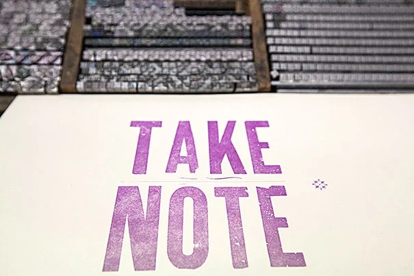"""Take Note,"" a symposium organized by the Radcliffe Institute for Advanced Study, explored the art and importance of effective note taking. As part of the symposium, participants visited the Bow & Arrow Press at Adams House (pictured) and the Harvard University Archives."