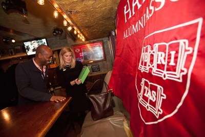 Michael Lewis '93 (left) and Cary Gemmer, assistant director of Classes and Reunions for the Harvard Alumni Association, watched election results at Tommy Doyle's in Harvard Square. Tuesday night's national elections sent a number of Harvard alumni and affiliates off to Washington.