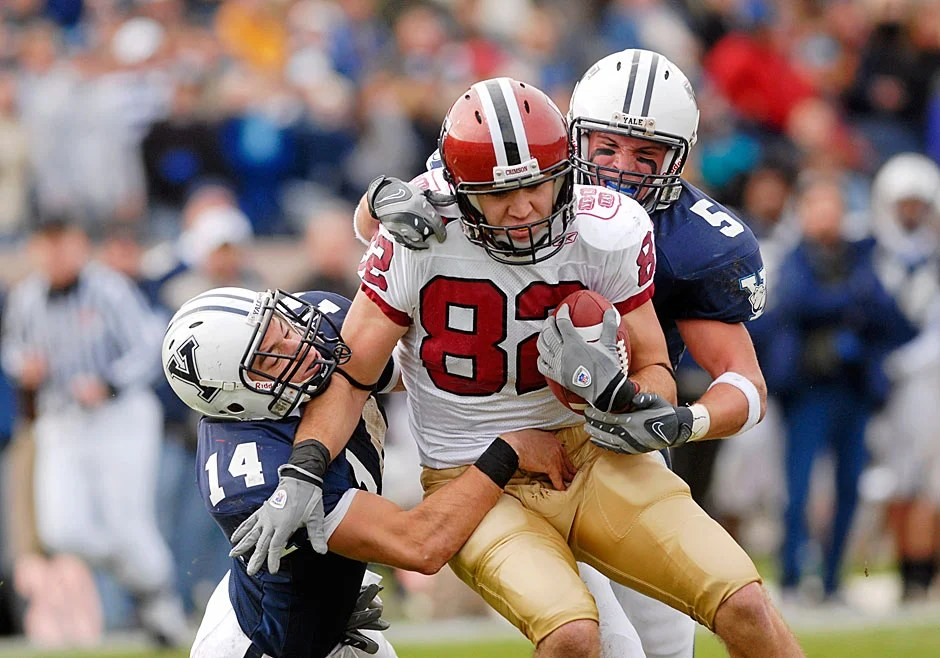 Harvard wide receiver Matt Luft '10 gets wrapped up by Yale defenders Steven Santoro (left) and Paul Rice after a long pass reception. Luft scored two touchdowns and garnered eight passes for 160 yards, as Harvard defeated their rivals, 37-6, in 2007.
