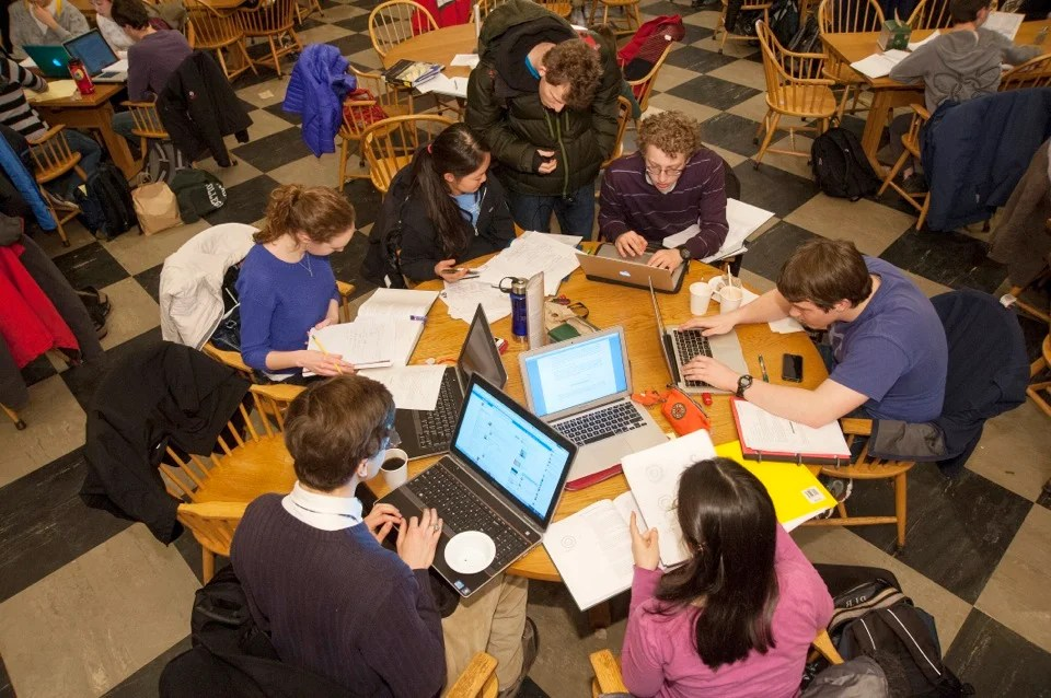 At Leverett House Physics Night, students gather around tables in the dining room to work on physics projects.