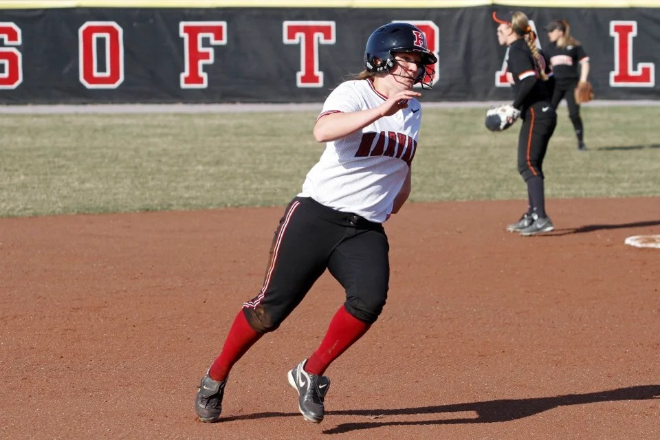Stephanie Regan '13 rounds third base on her way to scoring from second on a teammate's hit. Regan scored four times for the day.