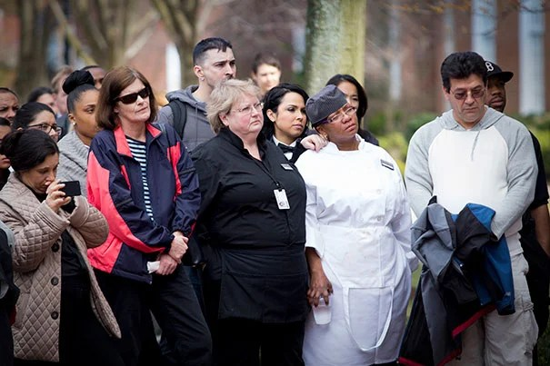 Harvard Business School co-workers and friends of the Campbell family gathered for a moment of silence outside Baker Library Tuesday.