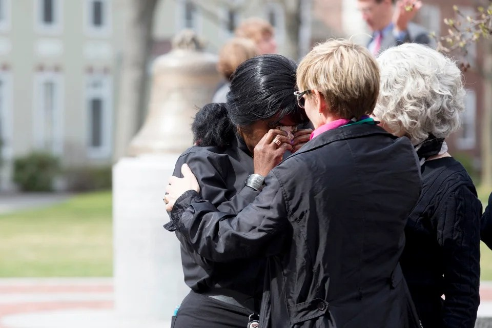Claire Aly (left) cries for her co-worker Patty Campbell, whose daughter was killed in the attacks.