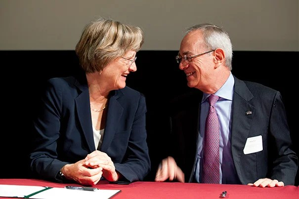 """Harvard is honored to be among the first signatories of the Community Compact,"" said President Drew Faust (left). ""We have much to gain from continuing to work together to confront climate change."" MIT President L. Rafael Reif (right) joined Faust, Cambridge Mayor Henrietta Davis, and City Manager Robert Healy in the ""Community Compact for a Sustainable Future"" signing ceremony."