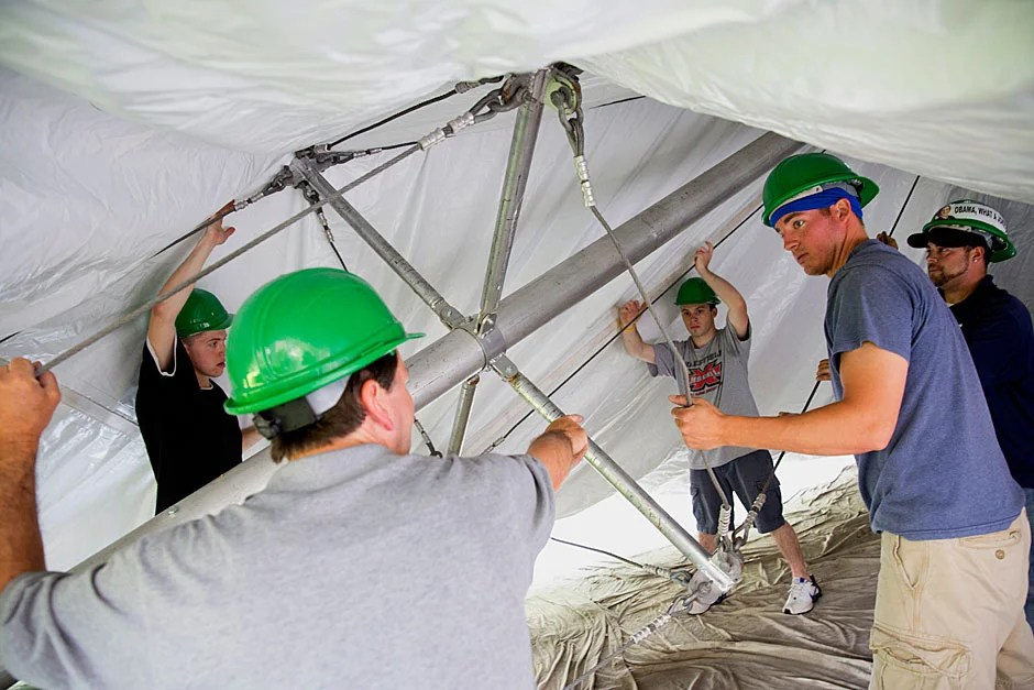 Workers from the William Blanchard Co. in Wakefield, Mass., raise the tent for Commencement inside Tercentenary Theatre. Kris Snibbe/Harvard Staff Photographer