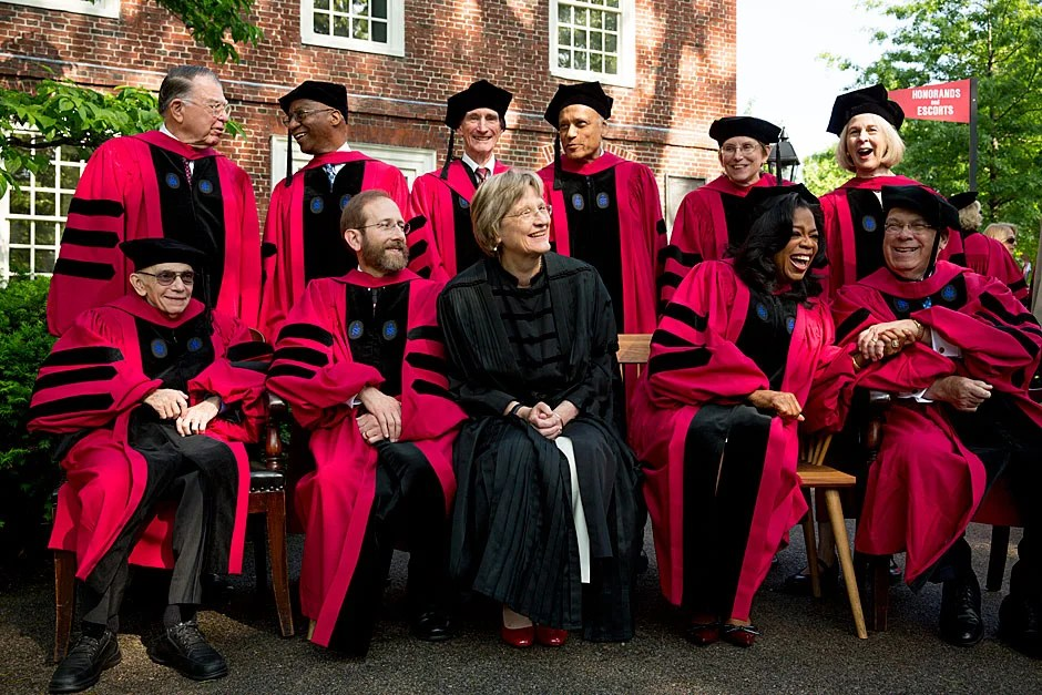 Honorands pose for a photo outside Massachusetts Hall. Among them is, of course, Oprah Winfrey — and to her right, Thomas M. Menino, Boston's longest-serving mayor. On the back row (from left) is C. Dixon Spangler Jr., Donald R. Hopkins, Lord May of Oxford, Sir Partha Dasgupta, JoAnne Stubbe, and Elaine Pagels. On the front row (from left) is Maestro Jose Antonio Abreu, Provost Alan M. Garber, President Drew Faust, Winfrey, and Menino. Stephanie Mitchell/Harvard Staff Photographer