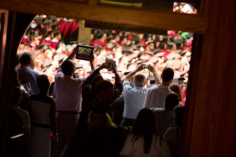 Proud family members photograph their daughters and sons — their new Harvard graduates! Stephanie Mitchell/Harvard Staff Photographer