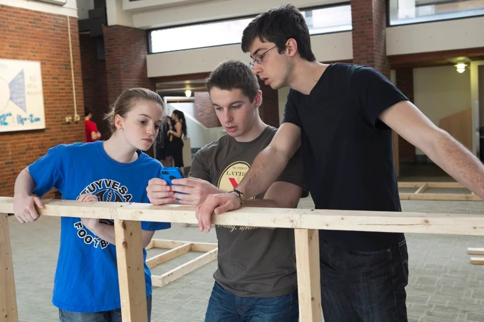 Ella Gibson '14 (from left), Max Shayer '14, and Renzo Lucioni '14 work on building the structure to house the 11th annual Mather Lather foam party.