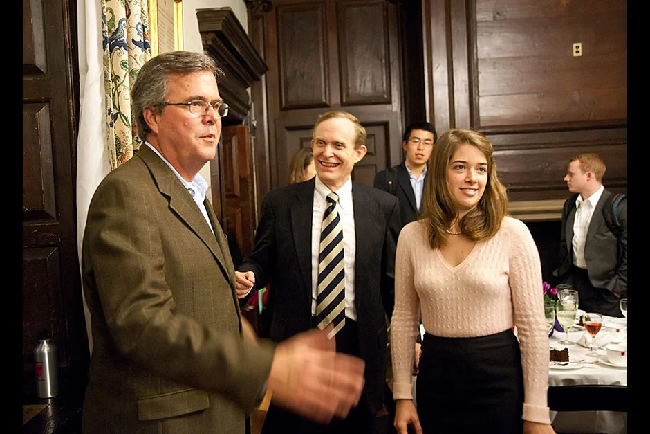 Former Florida Gov. Jeb Bush (left) greets students after a Dunster House dinner as House Master Roger Porter (center) looks on. Dinners like this one allow students to meet political and cultural figures in an intimate setting where they can ask questions and share ideas. Jon Chase/Harvard Staff Photographer