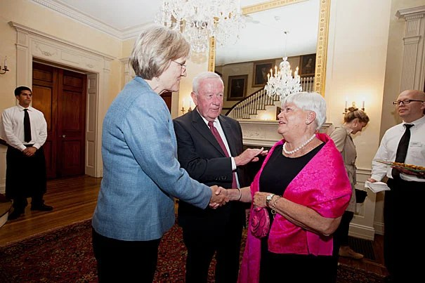 """""""Bob Healy has spent much of his impressive career bringing people with good ideas together and creating environments in which those ideas could take root and flourish,"""" said Harvard President Drew Faust (left) during a celebration of Robert Healy's (center) achievements and years of service as the city manager of Cambridge."""