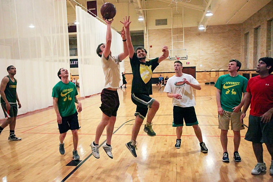 Team C members from Leverett House play basketball during an intrasquad game. Jon Chase/Harvard Staff Photographer