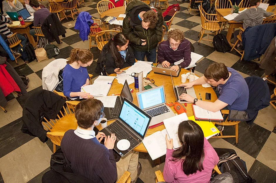 Students gather around tables in the dining room to confer on physics projects during Leverett House Physics Night. Jon Chase/Harvard Staff Photographer