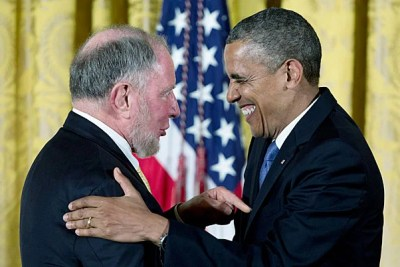 President Barack Obama laughs with Robert Putnam as he awards him the 2012  National Humanities Medal during a ceremony in the East Room of the White House on Wednesday.
