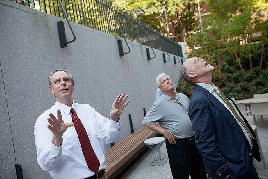 Architect Stephen Kieran from the firm KieranTimberlake, Quincy House Master Lee Gehrke, and Harvard College interim Dean Donald Pfister are seen in the new outdoor terrace.