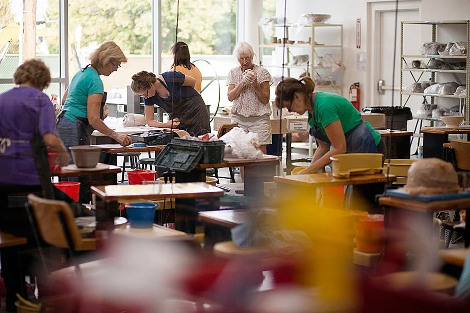 Students work in the large wheel throwing studio space.