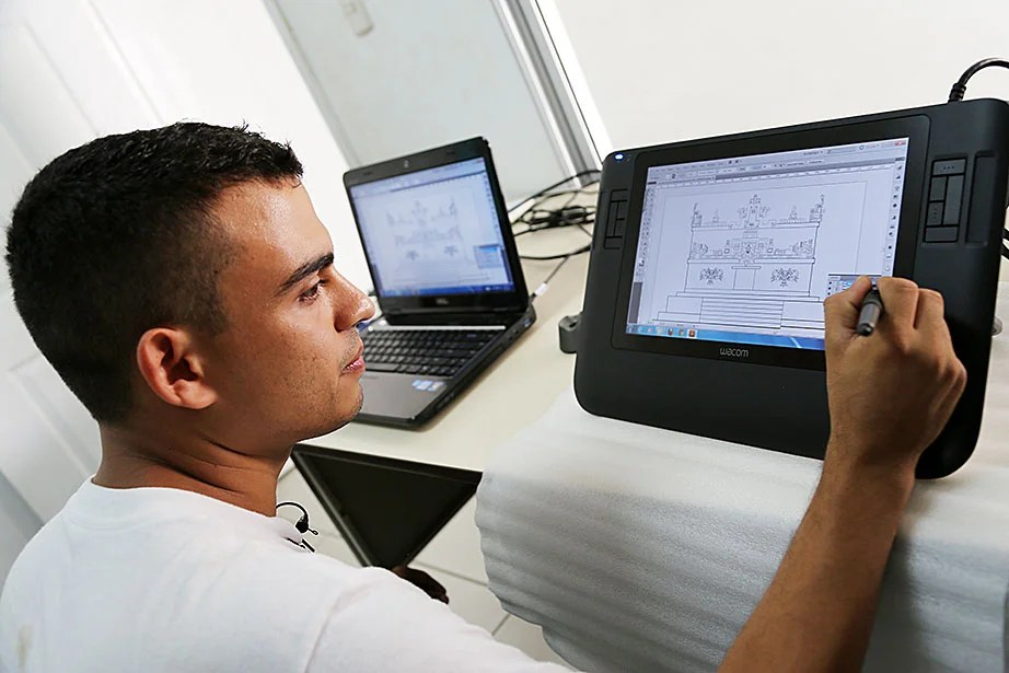 Jose Carlos Gonzalez, a member of the archaeological rescue and conservation team, draws a digital map of a structure at Rastrojón.