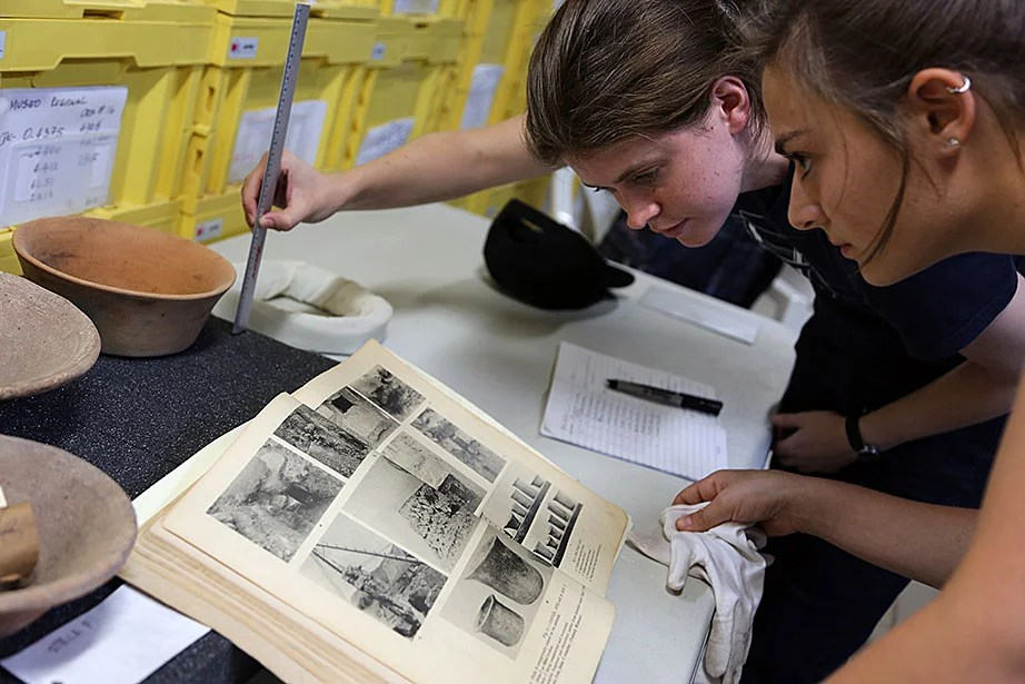 Harvard Ph.D. candidate Alexis Hartford (right) and Harvard graduate Katherine Brunson '08 examine pottery excavated in Copán in the 1930s.