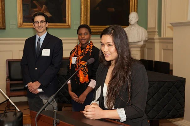 Weissman alum Li Murphy '15 spoke as fellow alums Mateus Falci '14 (left) and Naimonu James '14 listened (photo 1). Falci presented Harriet Weissman with a gift (photo 2). Diana Sorensen (from left), dean of arts and humanities, joined Weissman alum Michele Wu and Paul Weissman at the University Hall reception honoring the Weissmans.