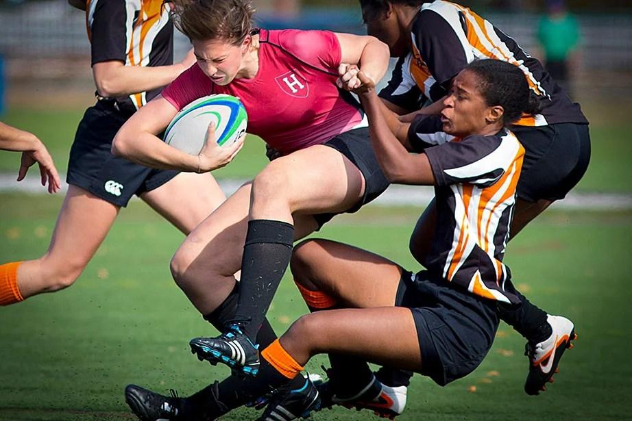 Cayla Calderwood gets taken down by Princeton defenders.