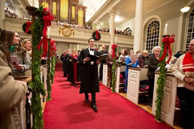"""They are great tunes,"" said Harvard choirmaster Edward E. Jones of ""Jingle Bells"" and ""Sleigh Ride"" — traditional holiday songs with a Harvard connection. Jones is seen here leading the 104th Annual Christmas Carols Service in Memorial Church."