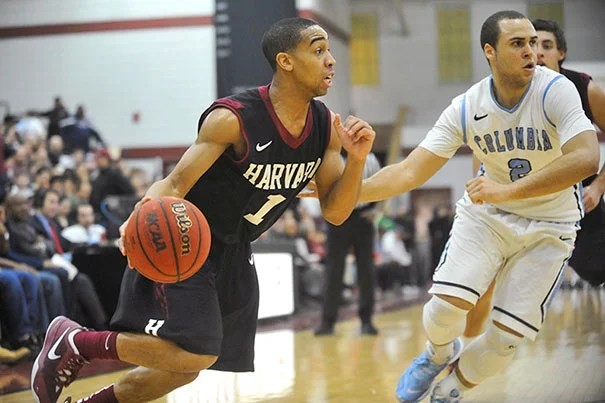 Siyani Chambers '16 went up against Columbia's Isaac Cohen (photo 1). Wesley Saunders '15 (photo 2) had 10 points, seven assists, and two steals. Brandon Curry '14 (photo 3) moved past Columbia's Meiko Lyles as Harvard beat Columbia 80-47.