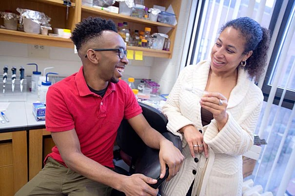 """Grad student Delbert André Green II (left) and Associate Professor Cassandra Extavour have been able to show how phenotypic plasticity may be connected to evolution in a single mechanism — insulin signaling in fruit flies. """"This is the first example, to my knowledge, that shows this link — between heritability and plasticity — being controlled by the same mechanism,"""" Extavour said."""