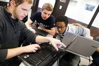 """Graduate students Aaron Kaufman (from left), Stephen Merity, and Kevin Kuate Fodouop crunch some numbers in Luke Bornn's (photo 2) class """"Statistics 183, Learning from Big Data."""""""