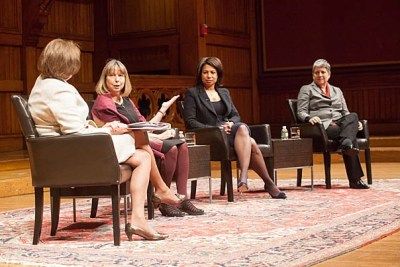 """At Sanders Theatre, a panel of top female leaders examined the evolving role of women. Karen Gordon Mills (from left, photo 1) posed questions to Jill Abramson, Edith Cooper, and Janet Napolitano, following an introduction by Harvard University President Drew Faust (photo 2). Faust called the gathering a """"critical conversation"""" about the challenges and opportunities women face today. """"What does power require of me beyond a thick skin?"""" she asked."""