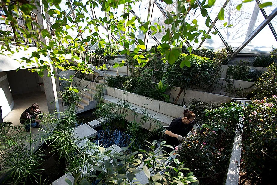 """""""I was thrilled to be given the chapel as one of my accounts. It couldn't have been better. It is peaceful and sunny. I see the reward. I'm really proud of my work,"""" said Liz Gallinaro (right), a technician with Four Seasons Greenery."""