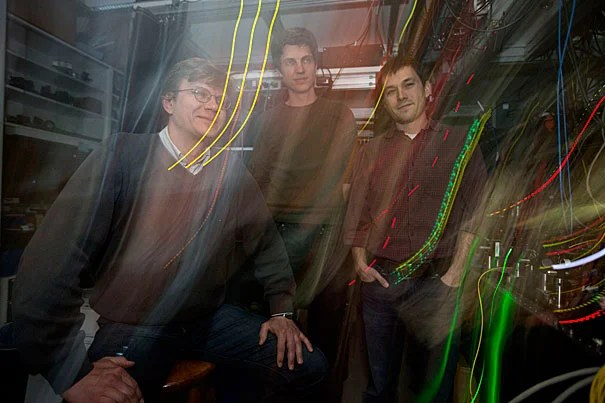 """Professor of Physics Mikhail Lukin (from left) led a team consisting of postdoctoral fellow Tobias Tiecke and graduate student Jeff Thompson that has created quantum switches that could one day be networked via fiber-optic cables to form the backbone of a """"quantum Internet"""" that allows for perfectly secure communications, said Lukin."""
