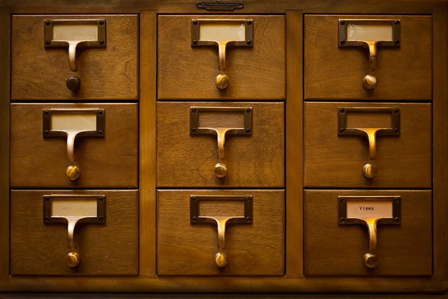 """A card catalog contains a """"shelflist"""" of the books with the cards inside arranged in call number order corresponding to the books on the shelves."""