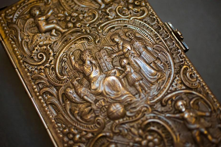 An elaborate silver relief binding covers a 1763 work by German scholar Johann Peter Miller.