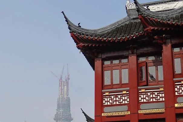 Economist Lawrence Summers and foreign policy expert Graham Allison talk about lessons learned from a Chinese research team's comparison of the conditions around the Great Depression and the recession of 2008. Pictured is Shanghai Tower during its construction, as seen from the Yuyuan Garden, located in the center of Shanghai's Old City.
